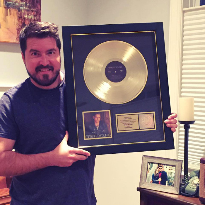 Jason Adamo receives first gold record as a songwriter on country artist Brett Young's debut album.